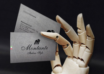 Wood hand holding blank business card